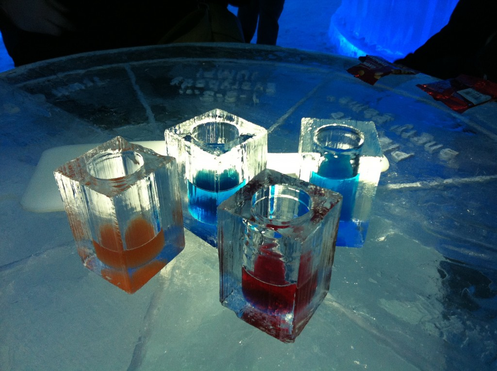 Drinks at the Ice Hotel - vodka cocktails in glasses made of ice, sitting on an ice table!