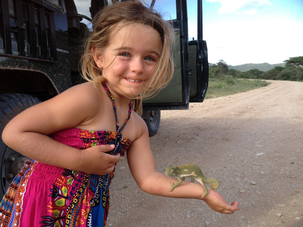 Halina holds a chameleon on the road to Amboseli.